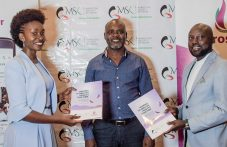 Prosper Mentor Founder & CEO Topyster Muga (left) exchanging mentorship agreements with Marketing Society of Kenya Chairman Charles Kariuki (right) while CEO Marketing Society of Kenya Edward Oswe (center) looks on.